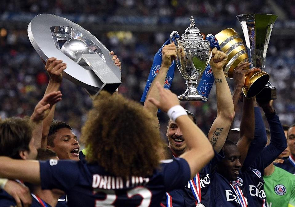 Paris Saint-Germain celebrate after winning the French Cup final against Auxerre at the Stade de France stadium in Saint-Denis, north of Paris, on May 30, 2015 (AFP Photo/Franck Fife)
