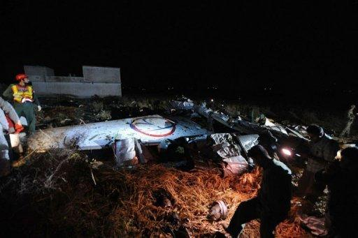 Pakistani rescue workers search through debris following the crash of a Bhoja Air Boeing 737 plane in the outskirts of Islamabad. The airline said the Boeing 737 was carrying 121 passengers, including 11 children, as well as six crew