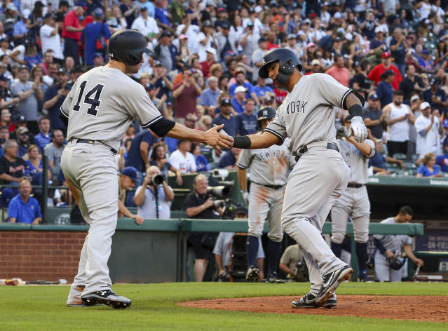 New York Yankees' Neil Walker (14) greets Gleyber Torres (25) at the plate after a home run against the Texas Rangers in the second inning of a baseball game Monday, May 21, 2018, in Arlington, Texas. (AP Photo/Richard W. Rodriguez)
