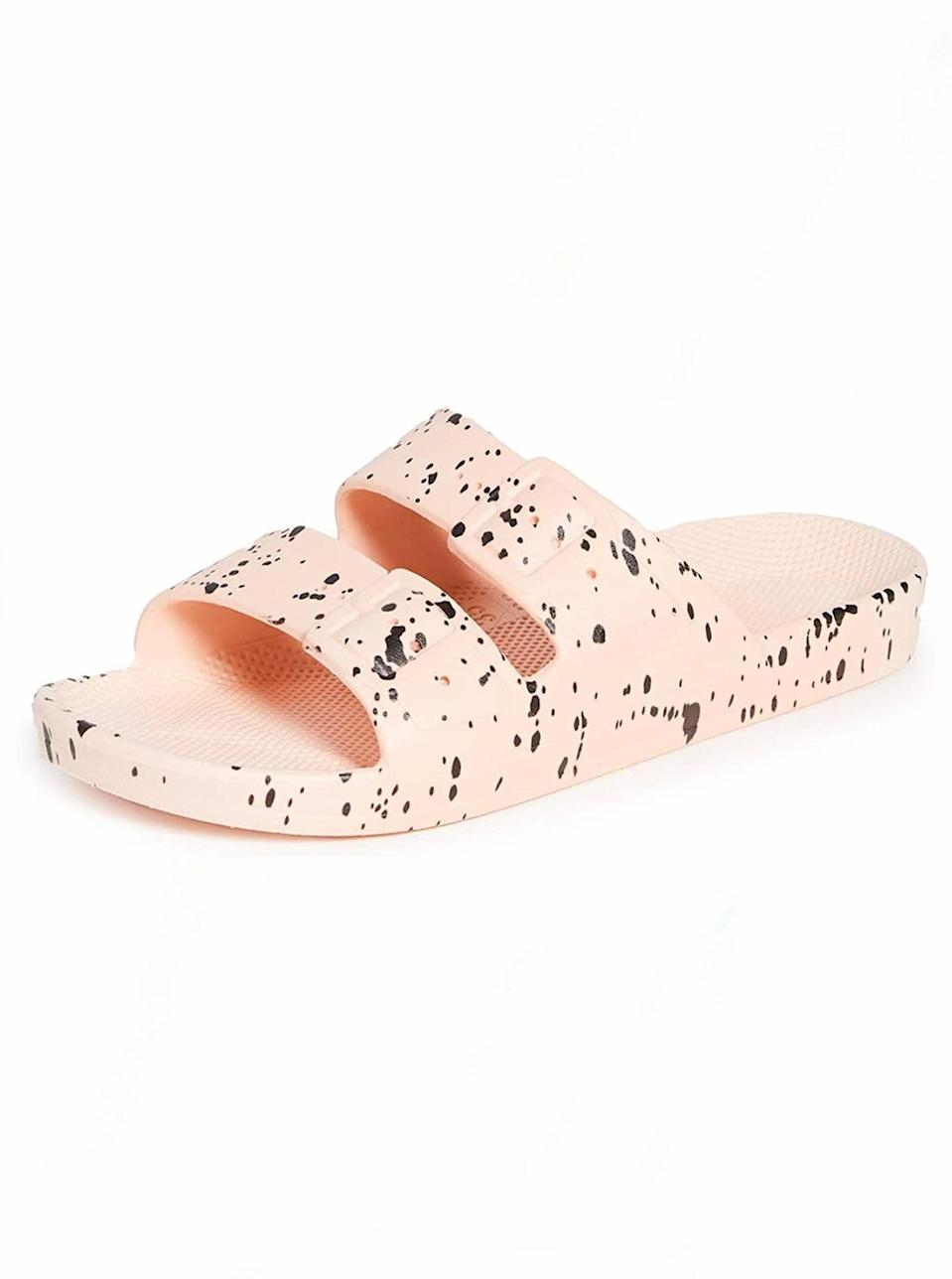 "These lightweight waterproof slides are a must for the mom who has a beach day or tropical vacay on her agenda this summer, and you can choose from countless other colors and prints if she's not into pink. $50, Amazon. <a href=""https://www.amazon.com/dp/B08B7V2BV1/ref="" rel=""nofollow noopener"" target=""_blank"" data-ylk=""slk:Get it now!"" class=""link rapid-noclick-resp"">Get it now!</a>"
