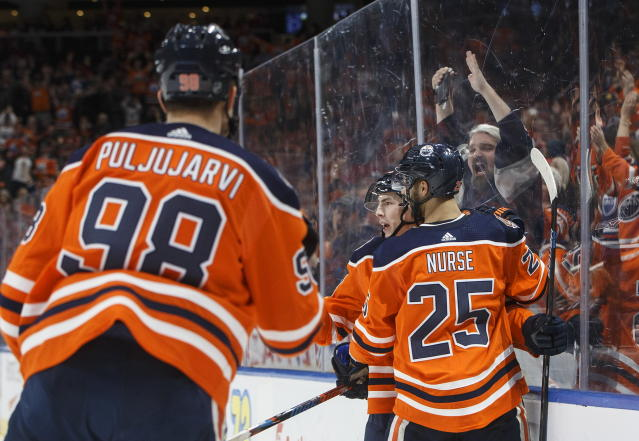 Edmonton Oilers' Jesse Puljujarvi (98), Darnell Nurse (25) and Ryan Nugent-Hopkins (93) celebrate a goal against the Calgary Flames during the second period of an NHL hockey game in Edmonton, Alberta, Saturday, Jan. 19, 2019. (Jason Franson/The Canadian Press via AP)