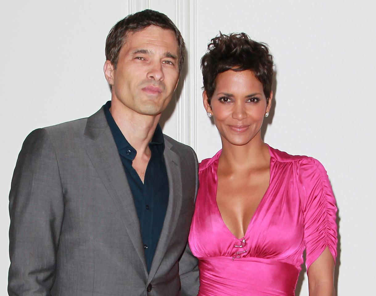 BEVERLY HILLS, CA - FILE:  Actors Olivier Martinez (L) and Halle Berry attend the 2011 Jenesse Silver Rose Auction and Gala at the Beverly Hills Hotel on April 17, 2011 in Beverly Hills, California.  According to reports January 11, 2012 Halle Berry and Oliver Martinez are engaged.  (Photo by David Livingston/Getty Images)