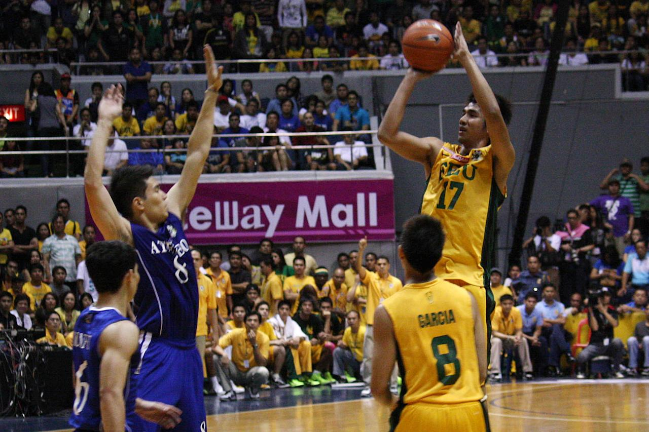 Aldrech Ramos of FEU Tamaraws goes for the basket against Ateneo Blue Eagles during the UAAP Season 74 first game of the best-of-three championship series held at Smart Araneta Coliseum in Quezon City. (Marlo Cueto/NPPA Images)
