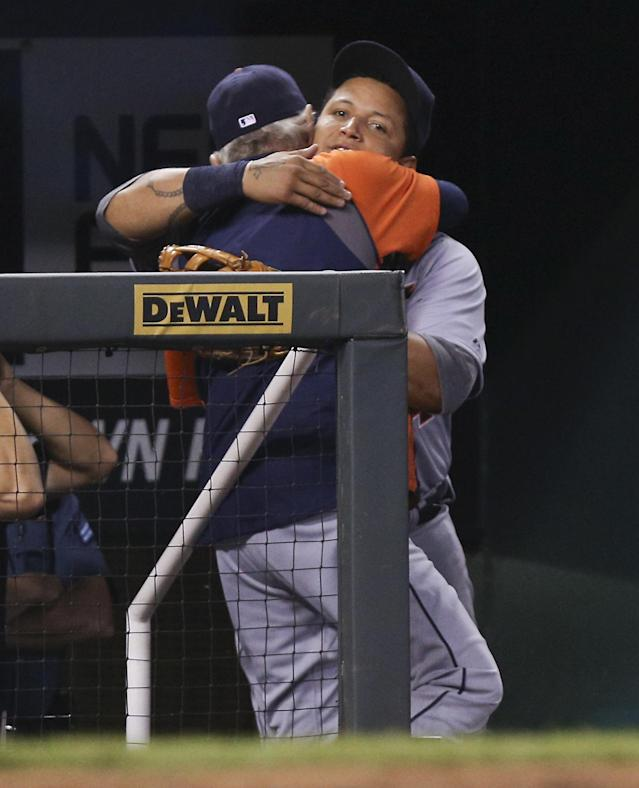 KANSAS CITY, MO - OCTOBER 3: Miguel Cabrera #24 of the Detroit Tigers hugs manager Jim Leyland as he leaves a game against the Kansas City Royals in the fourth inning at Kauffman Stadium on October 3, 2012 in Kansas City, Missouri. (Photo by Ed Zurga/Getty Images)