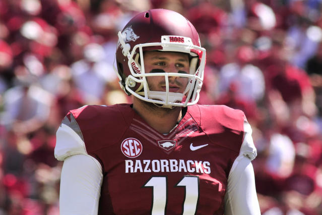 In this photo taken Sept. 14, 2013, Arkansas quarterback AJ Derby walks from the field during the second quarter of an NCAA college football game against Southern Mississippi in Fayetteville, Ark. Backup quarterback Derby may start against Rutgers depending on injured Brandon Allen's condition. (AP Photo/April L. Brown)