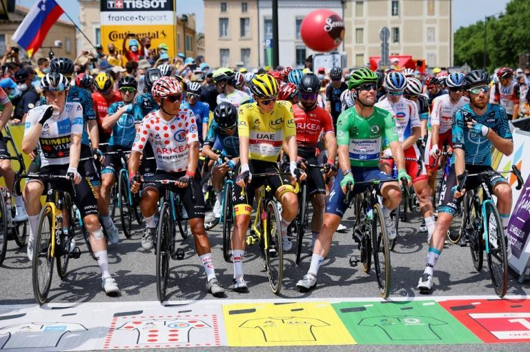 Jonas Vingegaard in the best young rider's white jersey, Nairo Quintana in the climber jersey, Tadej Pogacar in the overall leader's yellow jersey and Mark Cavendish in green