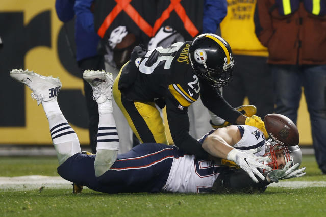 <p>Pittsburgh Steelers cornerback Artie Burns (25) breaks up a pass intended for New England Patriots tight end Rob Gronkowski (87) during the second half of an NFL football game in Pittsburgh, Sunday, Dec. 17, 2017. (AP Photo/Keith Srakocic) </p>