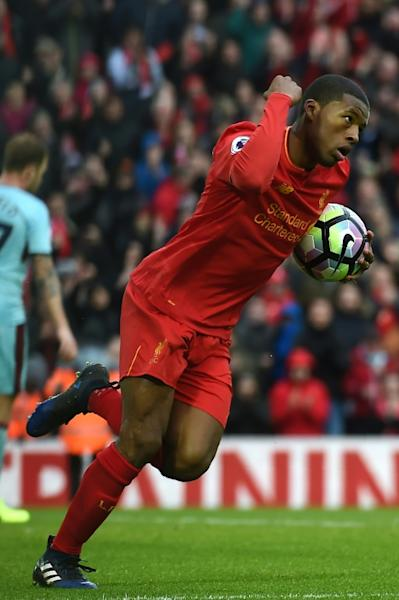 Liverpool's midfielder Georginio Wijnaldum celebrates after scoring their first goal during the English Premier League football match between Liverpool and Burnley at Anfield in Liverpool, north west England on March 12, 2017