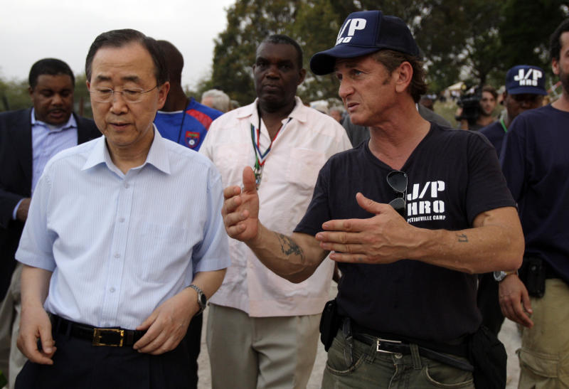 FILE - In this Sunday, March 14, 2010 file photo, U.N. Secretary-General Ban Ki-moon, left, listens to U.S. actor Sean Penn during his visit to a makeshift camp for earthquake survivors set up at the Petionville Golf Club in Port-au-Prince, Haiti. The actor who stormed onto the scene of one of the worst natural disasters in history two years ago has certainly not lost interest. Defying skeptics, he has put down roots in Haiti, a country he hadn't even visited before the January 2010 earthquake, and has become a major figure in the effort to rebuild. (AP Photo/Andres Leighton)