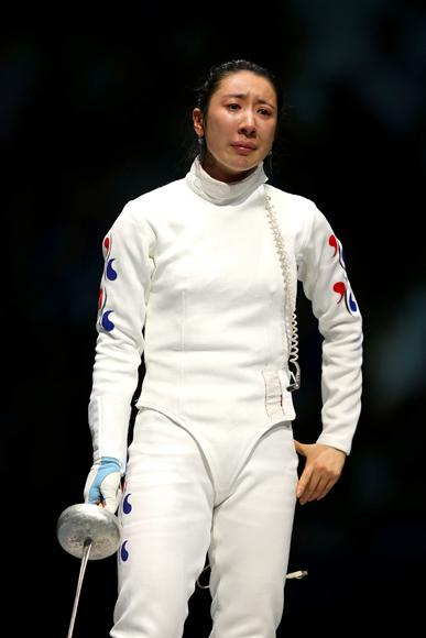 Tweets and Facebook postings took her side but fencing itself had stepped out of the shadows in 