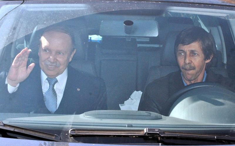 FILE - In this Friday April 10, 2009, file photo shows Algerian President Abdelaziz Bouteflika, left, and his brother, Said Bouteflika, arrive at his campaign headquarters in the Hydra district of Algiers, a day after the Algerian presidential election. In Algeria, which has been run by a succession of military men for decades, presidential elections often are foregone conclusion. But not this year. The campaign for the April vote already is raising questions: Will the ailing president run for re-election? If not, will his supporters and the powerful intelligence services be able to agree on someone else? And where does Algeria's army stand in all this? With the lack of any clear direction from on top, political squabbles are being fought in the media, with the head of the governing party decrying the shadowy intelligence chief's grip on power, and a journalist accusing the president's brother of corruption and scandalous personal behavior. (AP Photo, File)