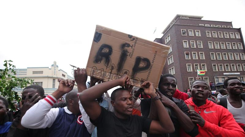 Protesters on the streets of Harare celebrate the downfall of Zimbabwe's President Robert Mugabe