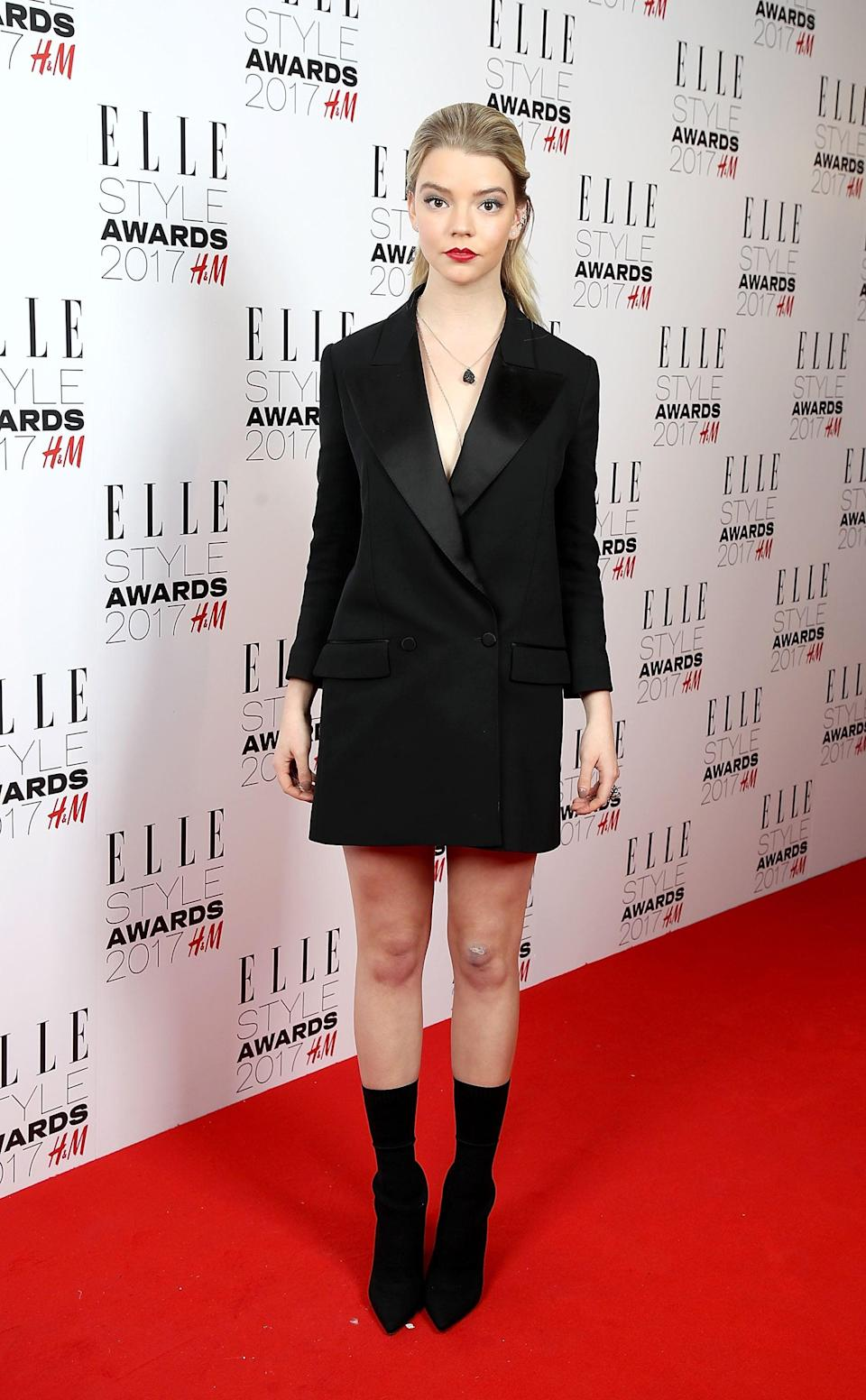 <p>Anya wore a Burberry tux jacket style dress.</p>