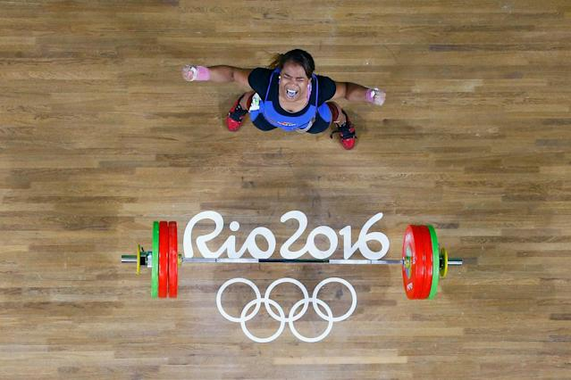 <p>Leidy Yessenia Solis Arboleda of Colombia reacts after lifting during the Women's 69kg Group A weightlifting contest on Day 5 of the Rio 2016 Olympic Games at Riocentro – Pavilion 2 on August 10, 2016 in Rio de Janeiro, Brazil. (Photo by Stoyan Nenov/ Pool – Getty Images) </p>