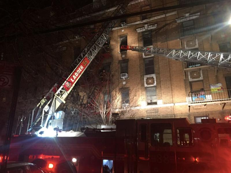 Firefighters responded toa massive blazeat a Bronx apartment building in which at least12 people had died late Thursday.