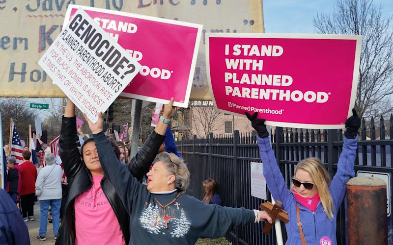 Rallies supporting Planned Parenthood have taken place across the country since Donald Trump came to power - AP