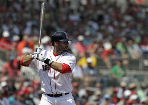 FILE - In this March 19, 2018, file photo, Boston Red Sox's J.D. Martinez bats against the Philadelphia Phillies during a spring training baseball game Monday, March 19, 2018, in Fort Myers, Fla. The Red Sox will top the major leagues with a payroll of about $223 million, after signing Martinez in the offseason. (AP Photo/Chris O'Meara, File)
