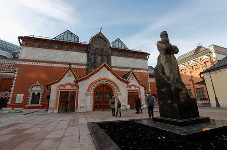 FILE PHOTO: People gather outside the State Tretyakov Gallery in Moscow