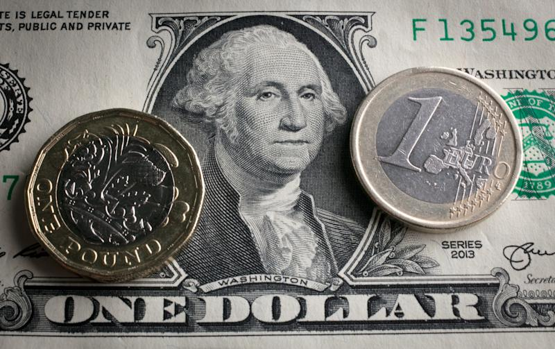 BATH, ENGLAND - OCTOBER 13: In this photo illustration, a £1 coin is seen a US dollar bill and 1 euro coin on October 13, 2017 in Bath, England. Currency experts have warned that as the uncertainty surrounding Brexit continues, the value of the British pound, which has remained depressed against the US dollar and the euro since the UK voted to leave in the EU referendum, is likely to fluctuate. (Photo Illustration by Matt Cardy/Getty Images)
