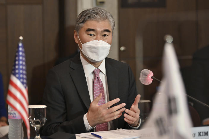 U.S. special representative for North Korea Sung Kim, speaks to South Korea's Special Representative for Korean Peninsula Peace and Security Affairs Noh Kyu-duk during their bilateral meeting at a hotel in Seoul Monday, June 21, 2021. (Jung Yeon-je/Pool Photo via AP)