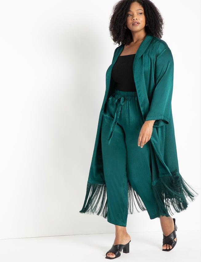 """<br><br><strong>Eloquii</strong> Satin Duster with Fringe Detail, $, available at <a href=""""https://go.skimresources.com/?id=30283X879131&url=https%3A%2F%2Fwww.eloquii.com%2Fsatin-duster-with-fringe-detail%2F1278044.html"""" rel=""""nofollow noopener"""" target=""""_blank"""" data-ylk=""""slk:Eloquii"""" class=""""link rapid-noclick-resp"""">Eloquii</a>"""