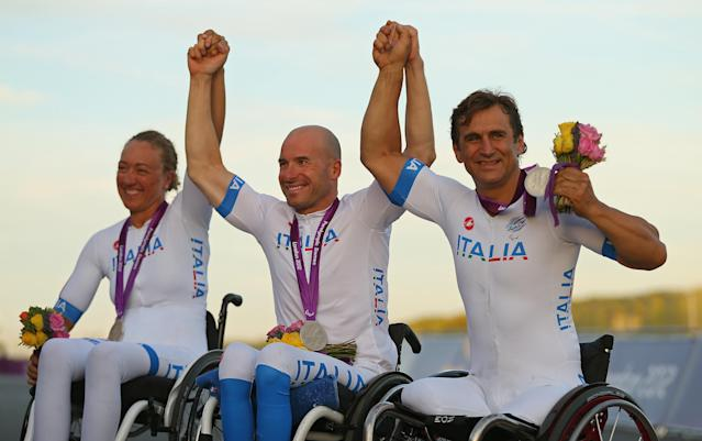 LONGFIELD, ENGLAND - SEPTEMBER 08: Francesca Fenocchio, Vittorio Podesta, and Alessandro Zanardi of Italy celebrates winning the Silver Medal in the Mixed H 1-4 Cycling Team Relay on day 10 of the London 2012 Paralympic Games at Brands Hatch on September 8, 2012 in Longfield, England. (Photo by Mike Ehrmann/Getty Images)