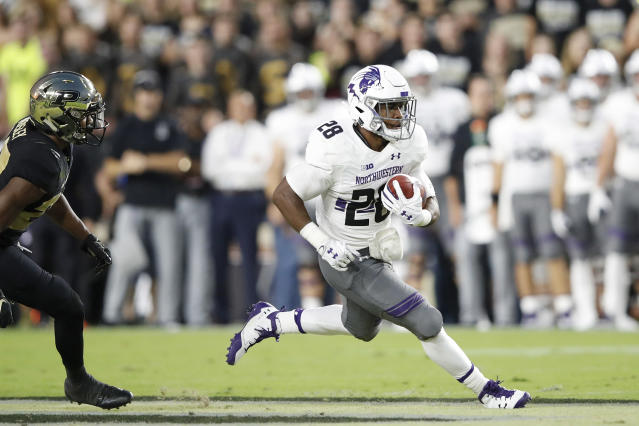 "Northwestern running back <a class=""link rapid-noclick-resp"" href=""/ncaaf/players/266566/"" data-ylk=""slk:Jeremy Larkin"">Jeremy Larkin</a> rushed for 143 yards in the win over Purdue. (Photo by Joe Robbins/Getty Images)"