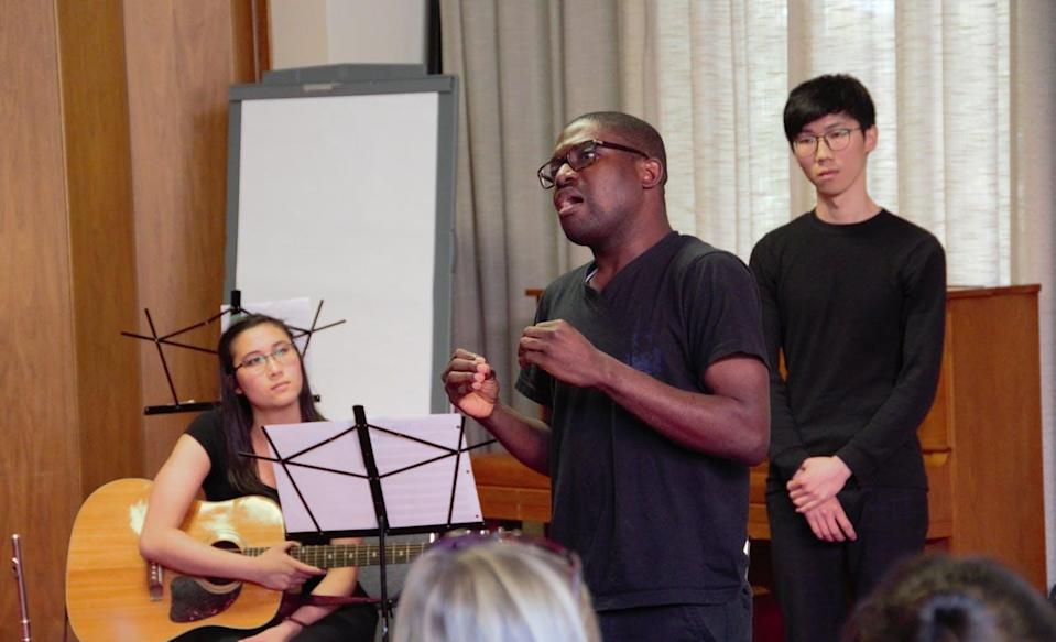 """<span class=""""caption"""">Olivia Wheeler, Taiwo Afolabi and Tianxu Zhao perform a play in honour of UN World Refugee Day, June 20, 2017, at Victoria City Hall.</span> <span class=""""attribution""""><span class=""""source"""">(John Threfall)</span>, <span class=""""license"""">Author provided</span></span>"""