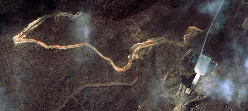 """This March 28, 2012 satellite image provided by DigitalGlobe shows the rocket engine test stand, right, and instrumentation site, left, at North Korea's Tongchang-ri Launch Facility on the nation's northwest coast.   An analysis of the March 28 images provided to The Associated Press by the U.S.-Korea Institute at Johns Hopkins School of Advanced International Studies showed Pyongyang """"has undertaken more extensive preparations for its planned April rocket launch than previously understood.""""   (AP Photo/DigitalGlobe) MANDATORY CREDIT, NO SALES"""