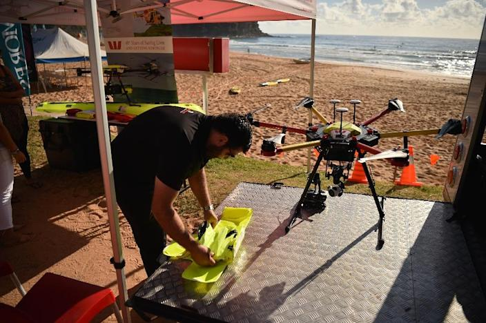 Australia is leading the use of the technology in surf lifesaving, with dozens of drones being trialled on beaches around the country (AFP Photo/PETER PARKS)