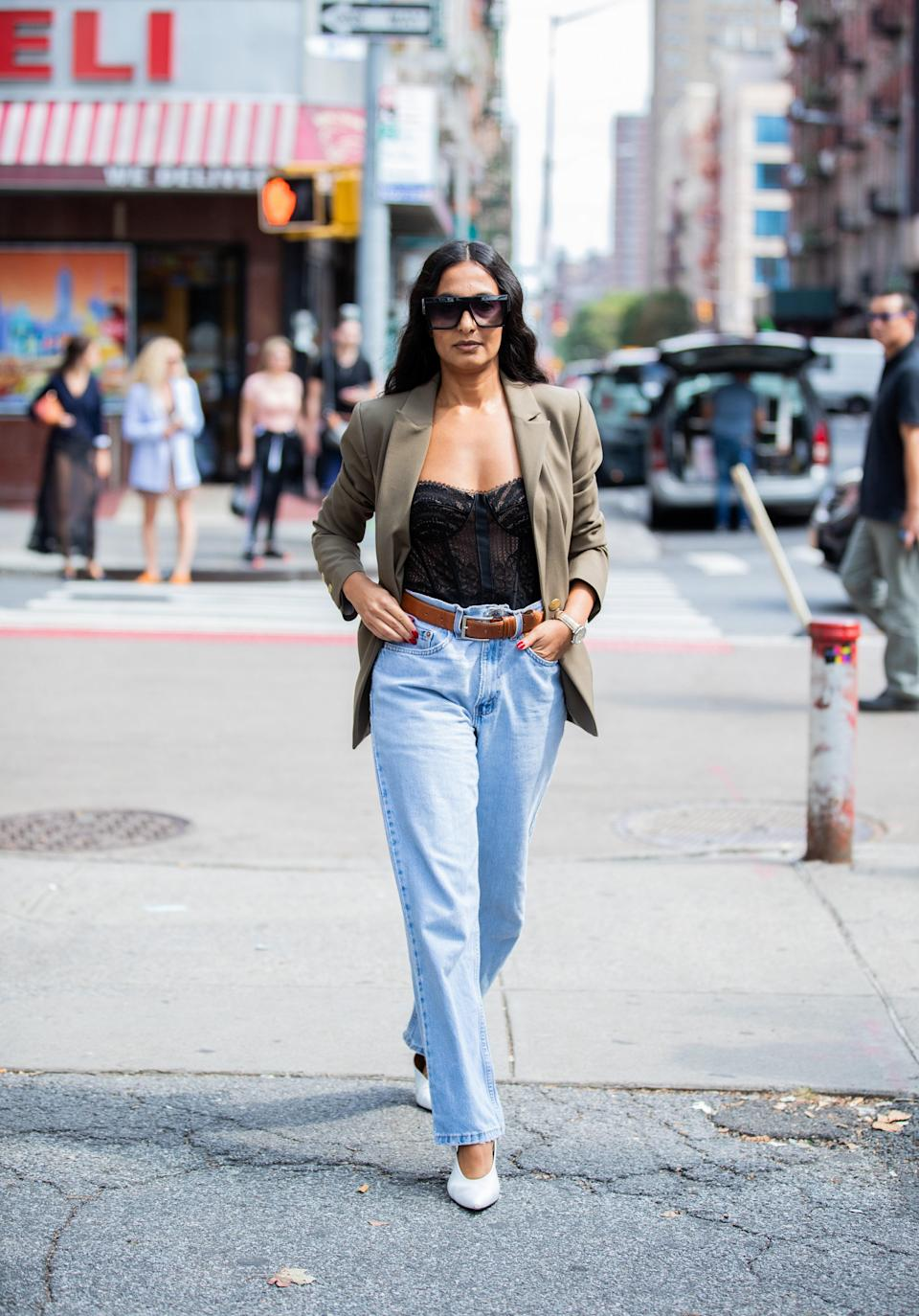 """Sweatpants are great and all, but <a href=""""https://www.glamour.com/gallery/best-jeans-for-women?mbid=synd_yahoo_rss"""" rel=""""nofollow noopener"""" target=""""_blank"""" data-ylk=""""slk:denim"""" class=""""link rapid-noclick-resp"""">denim</a> is truly forever. The new classic silhouette is the easy jean—a relaxed, high-waisted straight leg that looks as chic with a pair of pumps as it does with <a href=""""https://www.glamour.com/gallery/ugly-shoes?mbid=synd_yahoo_rss"""" rel=""""nofollow noopener"""" target=""""_blank"""" data-ylk=""""slk:dad sneakers"""" class=""""link rapid-noclick-resp"""">dad sneakers</a>."""