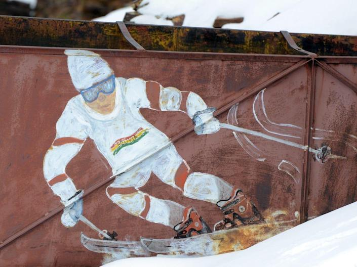 A mural of a skier painted on a building of the Chacaltaya ski resort.