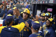 Milwaukee Brewers right fielder Avisail Garcia (24) after Milwaukee Brewers catcher Omar Narvaez hit an RBI single during the fourth inning of Game 4 of a baseball National League Division Series against the Atlanta Braves, Tuesday, Oct. 12, 2021, in Atlanta. (AP Photo/Brynn Anderson)