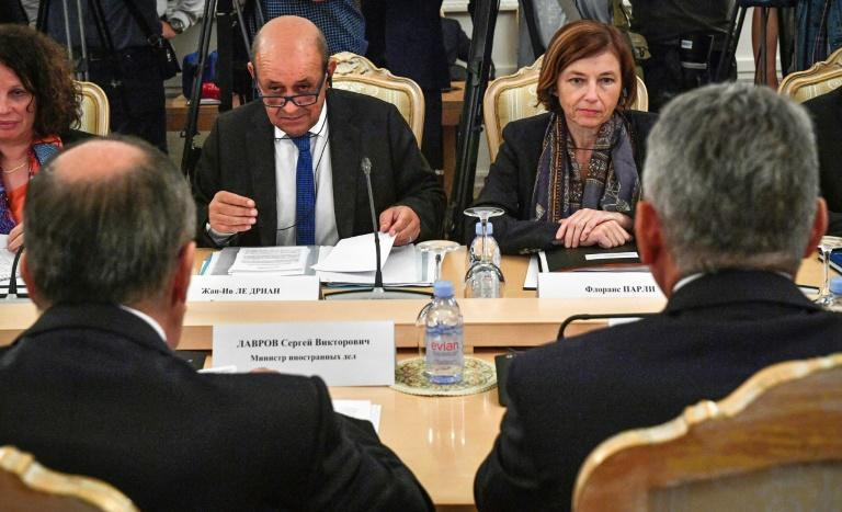 """French Foreign Minister Jean-Yves Le Drian (L) and Defence Minister Florence Parly held the first meeting in the so-called """"2+2"""" format suspended after Russia seized Crimea from Ukraine in 2014"""