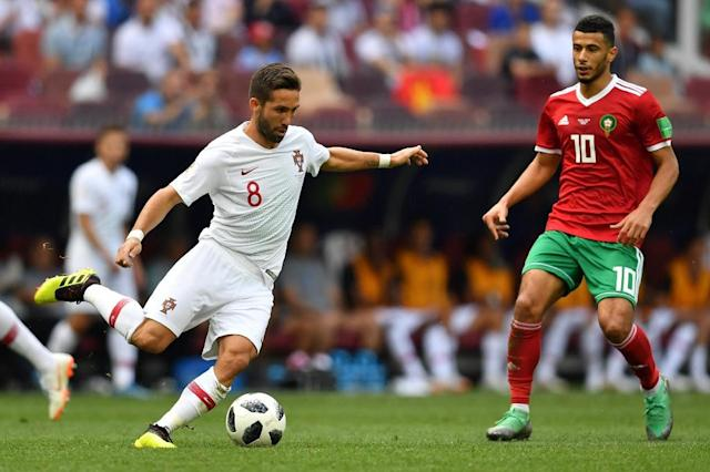 An illness affecting Joao Moutinho could force Fernando Santos into a reshuffle ahead of Portugal's game with Iran (AFP Photo/Yuri CORTEZ)