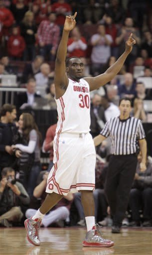 Ohio State's Evan Ravenel celebrates the team's impending win over Michigan State as time runs out in an NCAA college basketball game Sunday, Feb. 24, 2013, in Columbus, Ohio. Ohio State beat Michigan State 68-60. (AP Photo/Jay LaPrete)