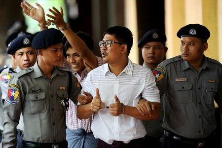 FILE PHOTO: Detained Reuters journalists Wa Lone and Kyaw Soe Oo arrive at Insein court in Yangon, Myanmar, Aug. 27, 2018. REUTERS/Ann Wang/File Photo