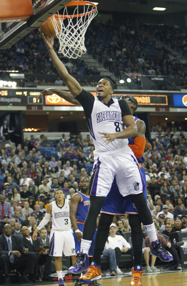 Sacramento Kings forward Rudy Gay (8) drives to the basket against New York Knicks defender Amar'e Stoudemire during the second half of an NBA basketball game in Sacramento, Calif., on Wednesday, March 26, 2014.The Knicks won 107-99.(AP Photo/Steve Yeater)