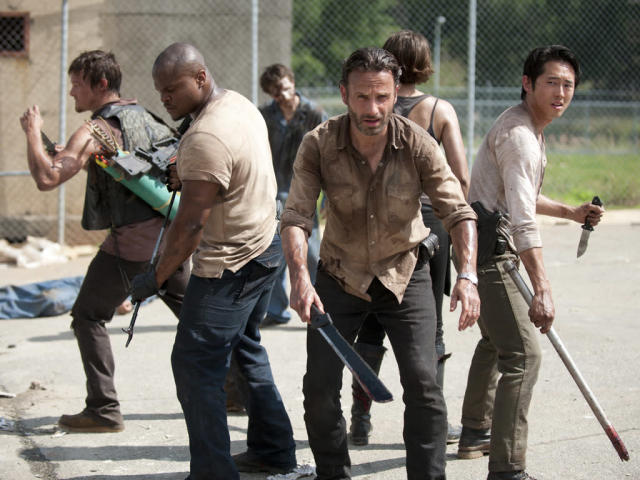 "Daryl Dixon (Norman Reedus), T-Dog (Robert 'IronE' Singleton), Rick Grimes (Andrew Lincoln), Maggie Greene (Lauren Cohan) and Glenn (Steven Yeun) in ""Seed,"" the Season Three premiere episode of ""The Walking Dead"" on AMC."