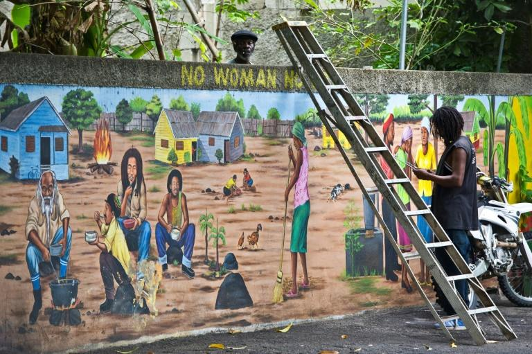 Museum staff working on a mural of Jamaican reggae legend Bob Marley at his museum in Kingston: reggae was added to UNESCO's list of world cultural treasures on November 29 2018