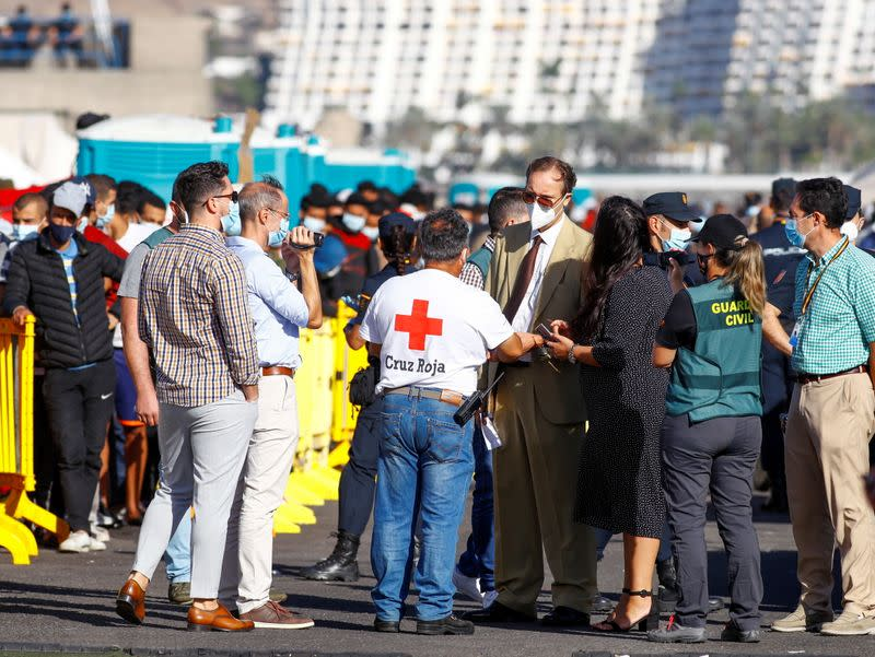 A judicial and police commission visit the camp where migrants rest after being rescued by coast guards or reached the island by their own means, in the Arguineguin harbour, on the island of Gran Canaria