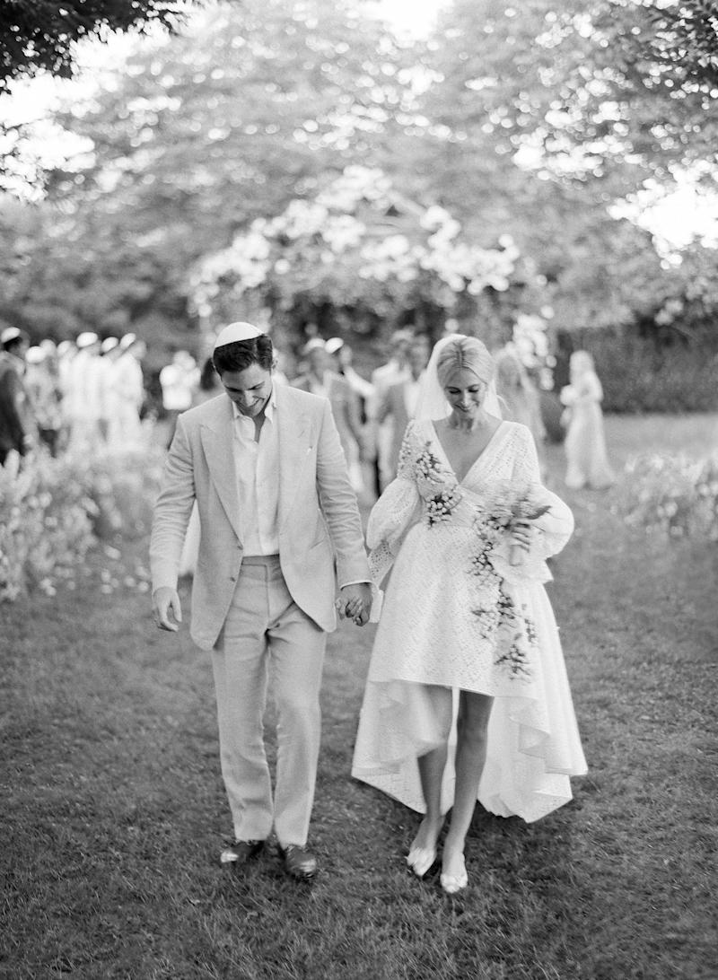 """Husband and wife! Beaming with joy, we walked down the aisle as newlyweds to """"Married Life."""""""