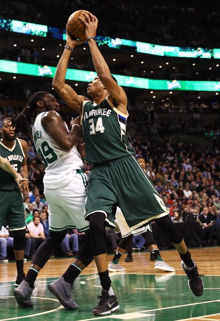 Giannis Antetokounmpo of the Milwaukee Bucks takes a shot against Jae Crowder of the Boston Celtics during the first quarter, at TD Garden in Boston, Massachusetts, on March 29, 2017 (AFP Photo/Maddie Meyer)
