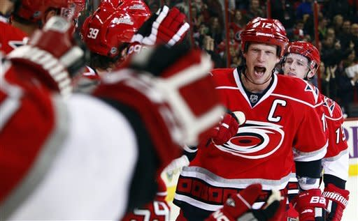 Carolina Hurricanes' Eric Staal (12) skates down the bench following his goal during the second period of an NHL hockey game against the Buffalo Sabres in Raleigh, N.C., Thursday, Jan. 24, 2013. Staal notched a hat trick in the Hurricanes' 6-3 win. (AP Photo/Karl B DeBlaker)