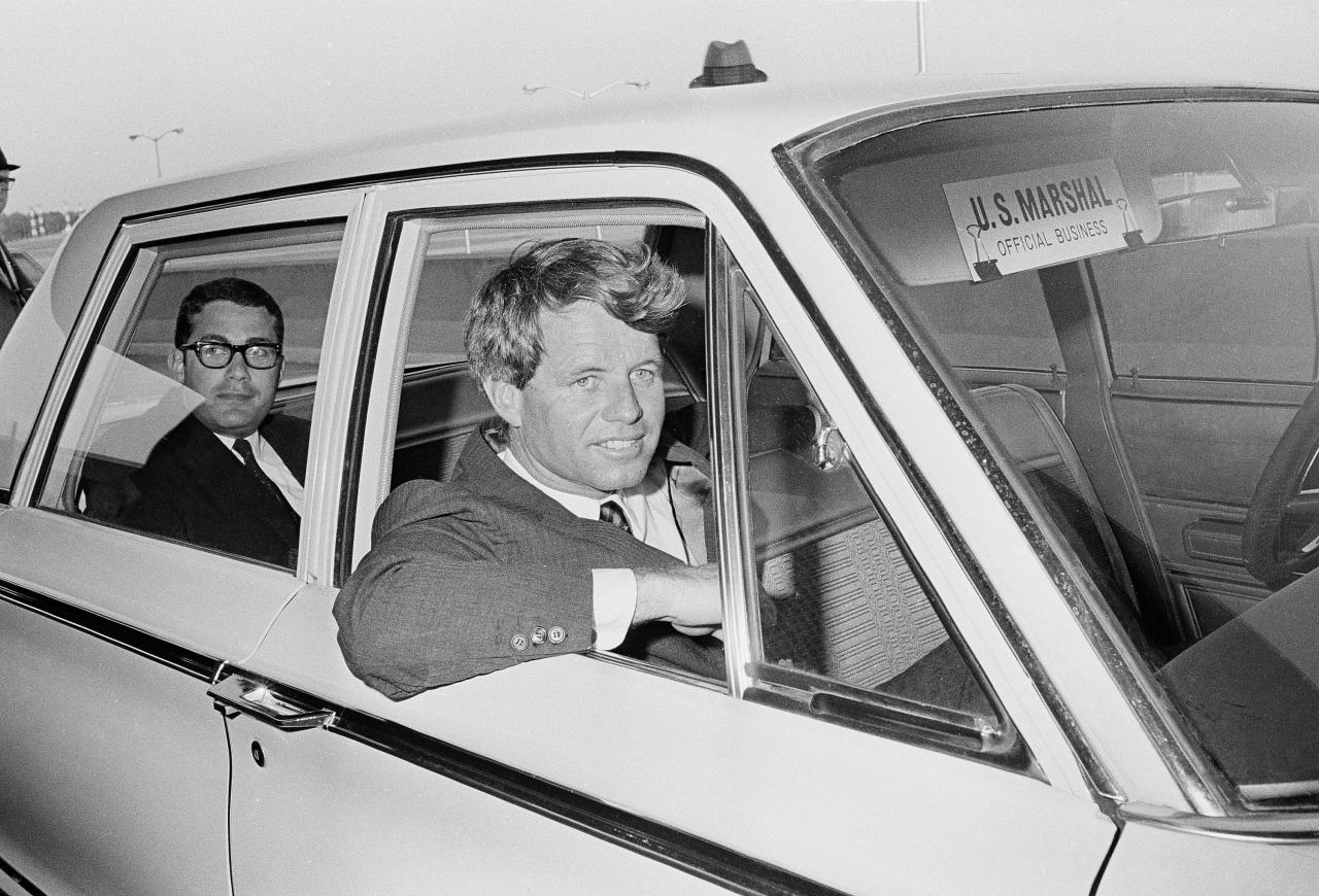 <p>Sen. Robert F. Kennedy sits in a U.S. Marshall car after his arrival at the Jackson, Miss., airport for an antipoverty hearing, April 10, 1967. (Photo: Jack Thornell/AP) </p>