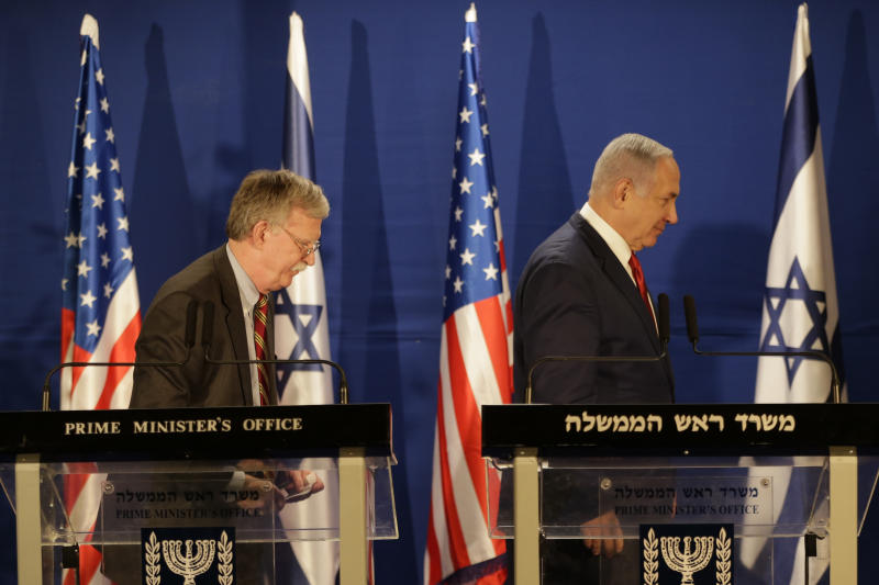 Israeli Prime Minister Benjamin Netanyahu, right, and US National Security Advisor John Bolton, leave the stage after their statement to the media follow their meeting, in Jerusalem, Sunday, Jan. 6, 2019. (AP Photo/Oded Balilty, Pool)