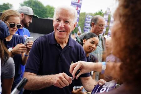 Biden smiles while signing autographs at the Polk County Democrats' Steak Fry in Des Moines, Iowa