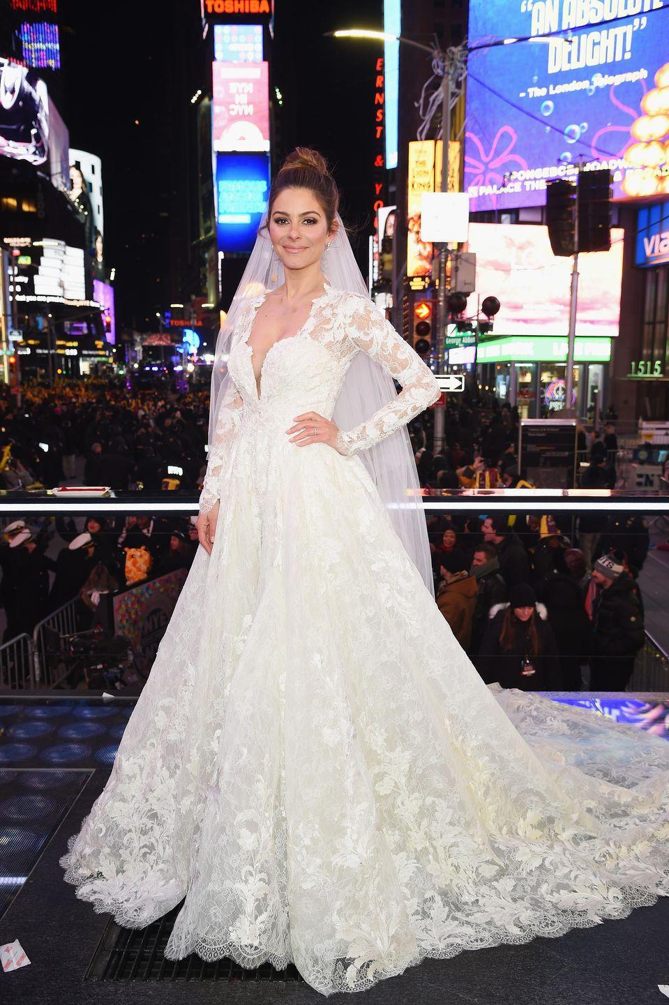 <p>Maria Menounos and her longtime boyfriend Keven Undergaro got engaged back in 2016. They decided to marry in the middle of Times Square on New Year's Eve in 2017 — and put it on live television, too. Maria wore a Pronovias gown <em>with</em> sleeves in an attempt to cover up as much skin as possible given the cold temps.</p>