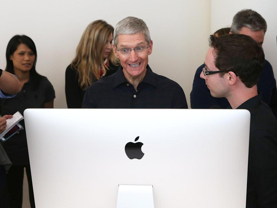Apple CEO Tim Cook looks at the new 27 inch iMac (Getty Images)