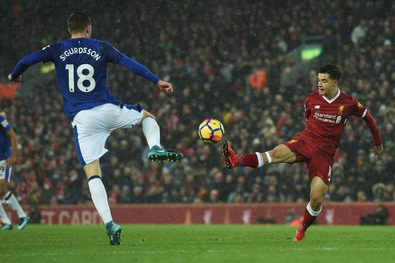 Liverpool's Philippe Coutinho (R) was left on the bench until the secodn half against Everton